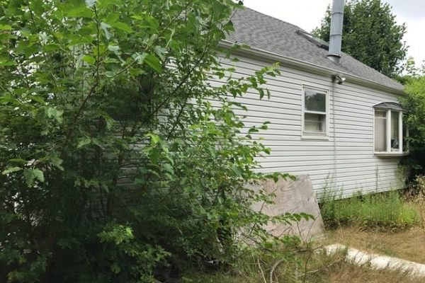 Rear exterior before photo of West Islip home