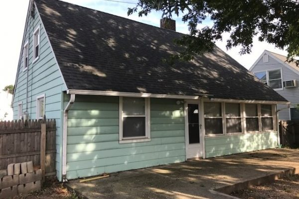 Before photo of the exterior of this Levittown home